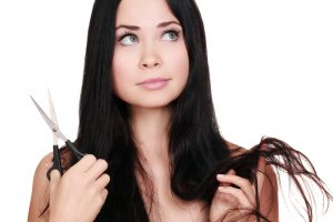 Photo of Woman with scissors, white background, copyspace